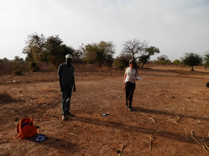 Nadia and a Beninois student undertaking field survey