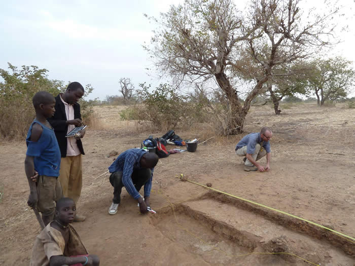 Setting out a test pit at a site downriver from Karimama, February 2011